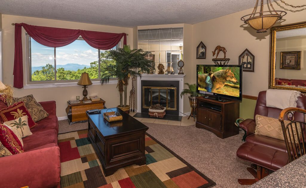 """42"""" TV/DVD & Fireplace in a comfortable living room with awesome mountain views"""